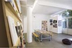 Installation view: reading room and poster wall